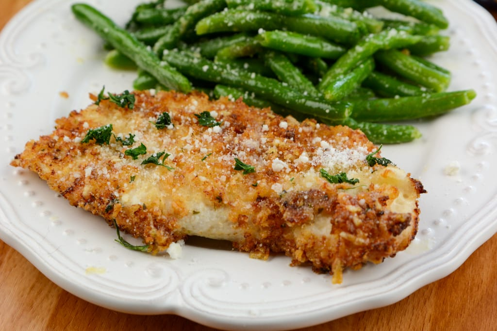 Air Fryer Parmesan Crusted Chicken I used half Panko bread crumbs and half Parmesan for this crushed chicken recipe. It adds the perfect crunchy coating to the chicken. Can I Use Bone In Chicken for Crusted Parmesan Chicken If you want to use bone in chicken you will need to add more time to cooking. Since the bone is in the chicken I suggest internally checking to ensure it is safe to serve.