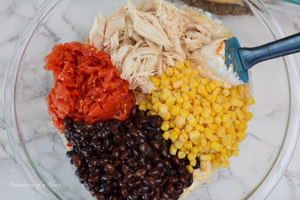 Add beans corn and tomatoes